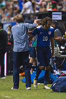 United States' Head Coach Jurgen Klinsmann pats midfielder Mix Diskerud (10) after substitution during an international friendly at the Alamodome, Wednesday, April 15, 2015 in San Antonio, Tex. USA defeated Mexico 2-0. (Mo Khursheed/TFV Media via AP Images)