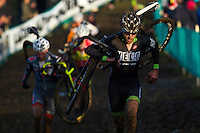 29 NOV 2014 - MILTON KEYNES, GBR - Jeremy Durrin (USA) from the USA carries his bike on his shoulder as he runs over a muddy stretch of the course during the men's 2014-2015 UCI Cyclo-Cross World Cup round at Campbell Park in Milton Keynes, Great Britain (PHOTO COPYRIGHT © 2014 NIGEL FARROW, ALL RIGHTS RESERVED)