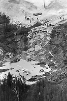 1980 FILE PHOTO - ARCHIVES -<br /> <br /> Mine BALMORAL, Val d'or, mai 1980, 8 mineurs sont prisonniers sous terre.<br /> <br /> Rescue mission: A helicopter hovers to drop high-powered pumps into a 200-foot-wide crater at the Belmoral mine in Val d'Or. Que.; where eight men have been trapped since Tuesday. The pumps were used to siphon off water and prevent another mudslide that could prove disastrous.<br /> <br /> 1980<br /> <br /> PHOTO :  Dick Loeb - Toronto Star Archives - AQP
