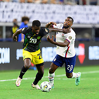 DALLAS, TX - JULY 25: Shaq Moore #20 of the United States and Kemar Lawrence #20 of Jamaica battle for control of the ball during a game between Jamaica and USMNT at AT&T Stadium on July 25, 2021 in Dallas, Texas.