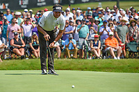 4th July 2021, Detroit, MI, USA;  Bubba Watson (USA) lines up his birdie putt on 18 during the Rocket Mortgage Classic Rd4 at Detroit Golf Club on July 4,