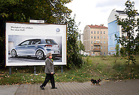 Old housing blocks, formerly in East Berlin, on the corner of Wolliner and Bernauer Strasse. The Wall used to run directly between these old apartment blocks and the Volkswagen advert, which would have been in the West.