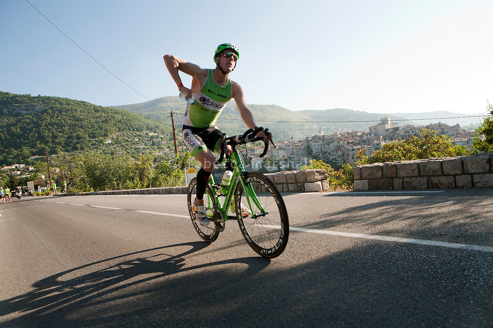 Axel Zeebroek cycles past the village of Tourettes sur Loup during Ironman France 2012, Nice, France, 24 June 2012