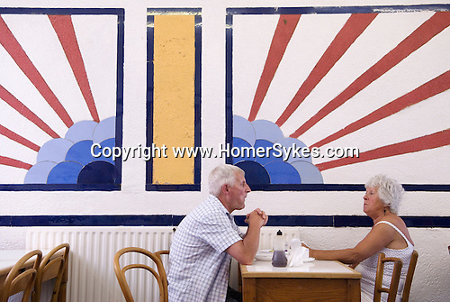 """An English """"sunrise"""" motif in a cafe  Southend on Sea, Essex. England. 2006. Baileys Fish and Chip shop. 2000s"""