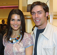Bal Harbour, FL 3-6-2002<br /> Angie Harmon & husband Jason Sehorn<br /> at the grand opening of The Luis <br /> Vuitton global store opening celebration.<br /> Photo by Adam Scull/PHOTOlink