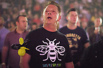 © Joel Goodman - 07973 332324 . No Editorial syndictaion permitted . 09/09/2017. Manchester , UK . A man with a Manchester Bee balloon animal on his arm and t-shirt from the event in the audience . We Are Manchester reopening charity concert at the Manchester Arena with performances by Manchester artists including  Noel Gallagher , Courteeners , Blossoms and the poet Tony Walsh . The Arena has been closed since 22nd May 2017 , after Salman Abedi's terrorist attack at an Ariana Grande concert killed 22 and injured 250 . Money raised will go towards the victims of the bombing . Photo credit : Joel Goodman