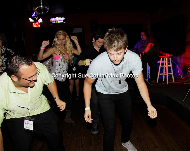 Chad Duell - General Hospital and Jared dance at 15th Southwest Florida Soapfest 2014 Charity Weekend with a Bartending/Karaoke get together on May 26, 2104 at Porky's, Marco Island, Florida. (Photo by Sue Coflin/Max Photos)