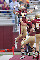 Boston College Eagles Wide Receiver Alex Amidon (#83)has help from OL Ian White (#62) celebrating his touchdown during a game versus the Wake Forest Demon Deacons at Alumni Stadium in Chestnut Hill, Massachusetts on October 1, 2011.Wake Forest would defeat the Eagles 27-19.Photo By Ken Babbitt/Four Seam Images