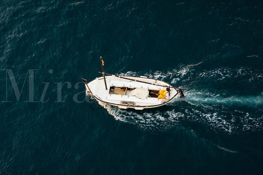 Fisherman on a small fishing boat at sea.