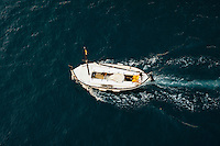 Fisherman on a small fishing boat at sea.