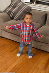 Two year old toddler boy standing full length portrait