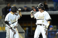 Vanderbilt Commodores Tyler Campbell (2) fist bumps Dansby Swanson (7) after scoring the game tying run during a game against the Indiana State Sycamores on February 20, 2015 at Charlotte Sports Park in Port Charlotte, Florida.  Vanderbilt defeated Indiana State 3-2.  (Mike Janes/Four Seam Images)