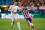 Atletico de Madrid's Guilherme Siqueira (r) and Real Madrid's Garet Bale during Champions League 2014/2015 Quarter-finals 1st leg match.April 14,2015. (ALTERPHOTOS/Acero)