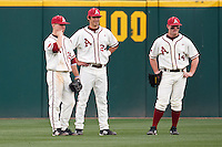 7th Inning stretch Collin Kuhn (25), Brett Eibner (24), Jarrod McKinney (14);March 10th, 2010; South Dakata State University vs Arkansas Razorbacks at Baum Stadium in Fayetteville Arkansas. Photo by: William Purnell/Four Seam Images
