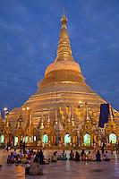 Myanmar, Burma.  Shwedagon Pagoda Illuminated at Night, Yangon, Rangoon.