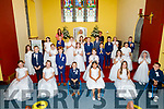 The First Holy Communion Class of Spa NS in the Church of the Purification Churchill on Saturday. L to r: Miss Hickey (Teacher), Fr Pat Crean Lynch and Geraldine Behan