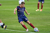 CHICAGO, UNITED STATES - AUGUST 25: Gaston Gimenez #30 of Chicago Fire kicks the ball during a game between FC Cincinnati and Chicago Fire at Soldier Field on August 25, 2020 in Chicago, Illinois.