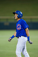 AZL Cubs second baseman Fidel Mejia (76) smiles as he walks back to first base after beating out the throw for an infield single during the game against the AZL Diamondbacks on August 11, 2017 at Sloan Park in Mesa, Arizona. AZL Cubs defeated the AZL Diamondbacks 7-3. (Zachary Lucy/Four Seam Images)