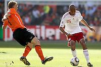 Dirk Kuyt of Holland and Simon Poulsen of Denmark.