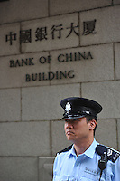 A policeman outside the Bank of China headquarters in Central, Hong Kong. Furious investors who bought Lehman Brothers minibonds have clashed with police outside the Bank of China headquarters. They are demanding a full refund of money they invested in minibonds, which were issued or guaranteed by the failed US investment bank..
