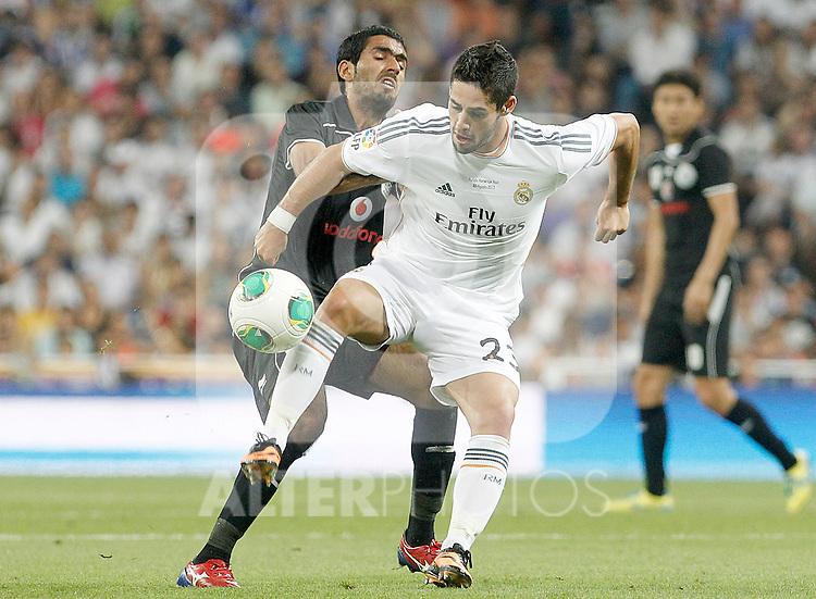 Real Madrid's Isco (r) and Al Sadd's Talal Ali Albloushiduring Santiago Bernabeu Trophy.August 22,2013. (ALTERPHOTOS/Acero)