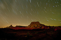 Star trails over canyons near Moab, Utah.