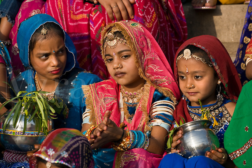 Rajasthani girls dressed in thier finest clothing and jewelry celebrate the GANGUR FESTIVAL also know as the MEWAR FESTIVAL - UDAIPUR, RAJASTHAN, INDIA
