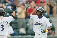 Justin Greene #1 of the Winston-Salem Dash high fives Eduardo Escobar #3 after hitting a home run against the Lynchburg Hillcats at  BB&T Ballpark May 22, 2010, in Winston-Salem, North Carolina.  Photo by Brian Westerholt / Four Seam Images