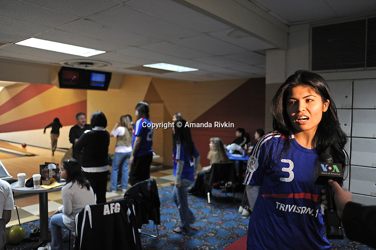 Tabasum Lutfi, 28, of Fairfax, Virginia, a Kabul-born immigrant who came to the U.S. at the age of ten, is interviewed by Voice of America television about the Afghan Sports Federation and the Afghan Bowling Tournament shortly after it got underway in Annandale, Virginia on February 28, 2010.