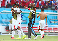 Costa Rica assistant manager Paulo Wanchope celebrates with his players at full time