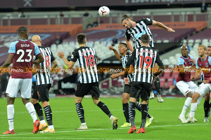 Andy Carroll of Newcastle United defends a West Ham cross during West Ham United vs Newcastle United, Premier League Football at The London Stadium on 12th September 2020