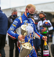 30th August 2020; Knockhill Racing Circuit, Fife, Scotland; Kwik Fit British Touring Car Championship, Knockhill, Race Day; Ashley Sutton leaves the podium with the trophies and champagne after winning round 11 of the BTCC