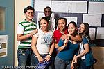 High school students posing in corridor.