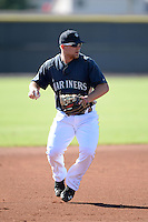 Seattle Mariners third baseman Joe DeCarlo (4) during practice before an Instructional League game against the Milwaukee Brewers on October 4, 2014 at Peoria Stadium Training Complex in Peoria, Arizona.  (Mike Janes/Four Seam Images)
