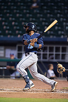 Corpus Christi Hooks catcher Chuckie Robinson (15) connects on a pitch Wednesday, May 1, 2019, at Arvest Ballpark in Springdale, Arkansas. (Jason Ivester/Four Seam Images)