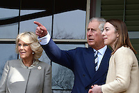 Washington, DC - March 19, 2015: His Royal Highness The Prince of Wales points to a building across from the Abraham Lincoln Cottage in the District of Columbia,  March 19, 2015, during a four-day USA visit, as the Duchess of Cornwall (l) looks on. Michelle Smith (r), Benefactor of the Lincoln Cottage, guided the tour. (Photo by Don Baxter/Media Images International)