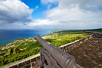 Brimstone Hill Fortress Cannons, a UNESCO World Heritage site above the turquoise sea, in Saint Kitts & Nevis Island, Caribbean Leeward Islands