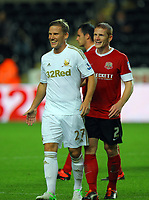 Pictured L-R: Mark Gower of Swansea and Bobby Hassell of Barnsley. Tuesday 28 August 2012<br /> Re: Capital One Cup game, Swansea City FC v Barnsley at the Liberty Stadium, south Wales.