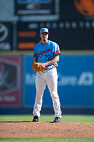 Spokane Indians starting pitcher Chi Chi Gonzalez (22) gets ready to deliver a pitch in a rehab assignment during a Northwest League game against the Vancouver Canadians at Avista Stadium on September 2, 2018 in Spokane, Washington. The Spokane Indians defeated the Vancouver Canadians by a score of 3-1. (Zachary Lucy/Four Seam Images)