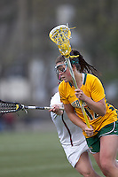 University of Vermont midfielder Emma Kelly (12) on the attack. Boston College defeated University of Vermont, 15-9, at Newton Campus Field, April 4, 2012.