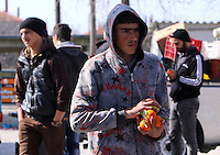 Pictured: Oranges given to refugees by the farmers at the road block Tuesday 23 February 2016<br /> Re: Migrants on their way back to Athens have been caught by the blocked off motorway at Tembi, where local farmers have closed off the road, protesting against pension and welfare reforms near Trikala, Greece.