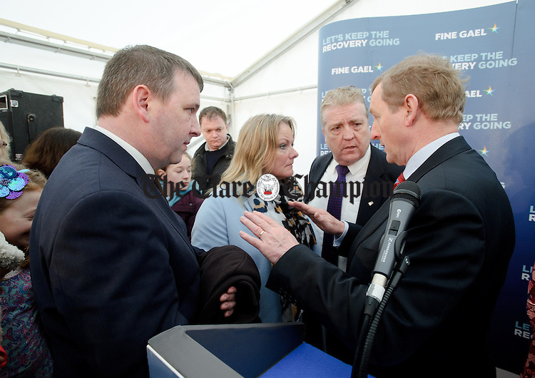 Enda Kenny, Taoiseach speaking with candidates Joe Carey, TD, Councillor Mary Howard and Pat Breen, TD during his visit to Loop Head to launch the Fine Gael tourism initiative. Photograph by John Kelly.
