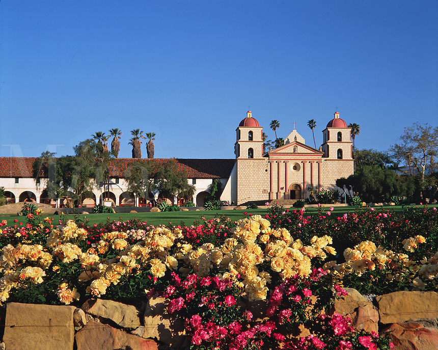 Exterior view of the Mission Santa Barbara 'Queen of the Missions' as seen from behind a flower garden. Santa Barbara, California.