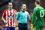 Referee Cuneyt Cakir have words with Atletico de Madrid's Diego Godin (l) and Jan Oblak (r) during Champions League 2017/2018, Group C, match 2. September 27,2017. (ALTERPHOTOS/Acero)