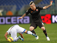 Calcio, Tim Cup: Roma vs Empoli. Ottavi di finale a gara unica. Roma, stadio Olimpico, 20 gennaio 2015.<br /> Roma's Radja Nainggolan and Empoli's Vincent Laurini, left, fight for the ball during the Italian Cup round of 16 football match between Roma and Empoli at Rome's Olympic stadium, 20 January 2015.<br /> UPDATE IMAGES PRESS/Riccardo De Luca
