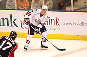 December 30th, 2007:  Marc-Andre Gragnani (21) of the Rochester Amerks controls the puck during the second period of play.  The Syracuse Crunch shutout the Rochester Amerks 4-0 to earn the win at Blue Cross Arena at the War Memorial in Rochester, NY. Photo Copyright Mike Janes Photography 2007.