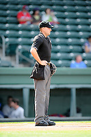 Home plate umpire Kyle Wallace in a game between the Greenville Drive and the Asheville Tourists on Friday, April 24, 2015, at Fluor Field at the West End in Greenville, South Carolina. (Tom Priddy/Four Seam Images)