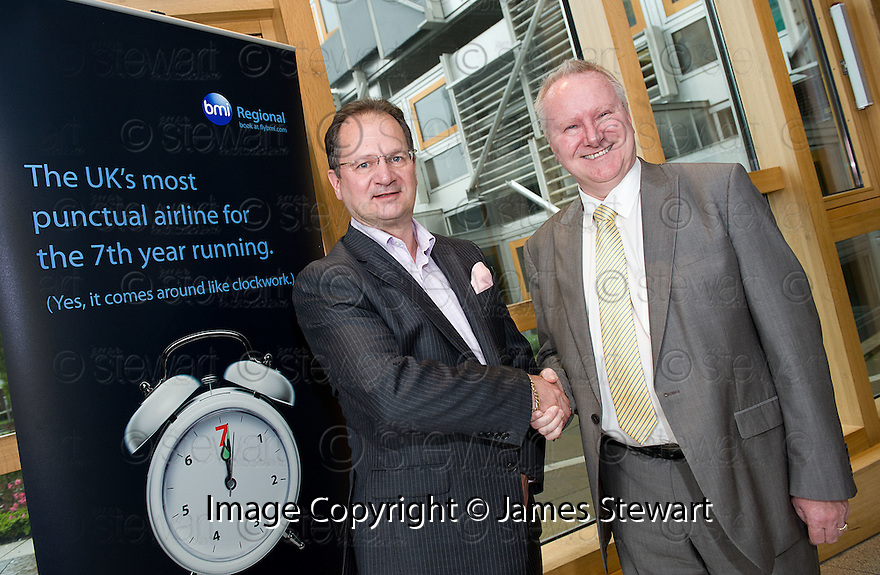 Cabinet Secretary for Infrastructure and Capital Investment, Alex Neil MSP (right),  with Graeme Ross, Business Development Director, BMI Regional, at the announcement of the sale of BMI Regional's sale from IAG to Sector Aviation  Holdings (SAH) .............31/05/2012    jsp003_bmi   .Copyright  Pic : James Stewart.James Stewart Photography 19 Carronlea Drive, Falkirk. FK2 8DN      Vat Reg No. 607 6932 25.Telephone      : +44 (0)1324 570291 .Mobile              : +44 (0)7721 416997.E-mail  :  jim@jspa.co.uk.If you require further information then contact Jim Stewart on any of the numbers above........