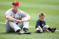 April 11, 2010:  Adam Fox of the Harrisburg Senators sits with his nephew before a game at Blair County Ballpark in Altoona, PA.  Harrisburg is the Double-A Eastern League affiliate of the Washington Nationals.  Photo By Mike Janes/Four Seam Images