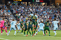 ST PAUL, MN - JULY 24: Bakaye Dibassy #12 of Minnesota United FC goes for the ball in the box during a game between Portland Timbers and Minnesota United FC at Allianz Field on July 24, 2021 in St Paul, Minnesota.